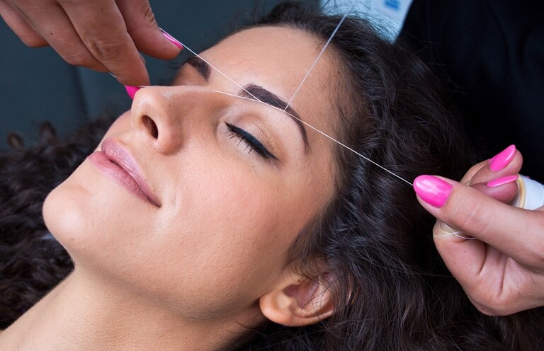 Threading being performed on eyebrows