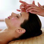 Brunette Lady getting facial massage