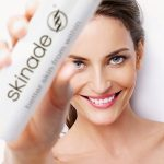 woman with skinade bottle