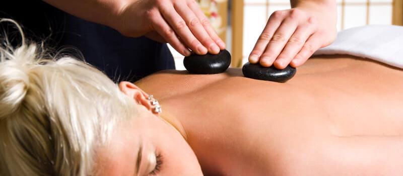 Blonde Girl Receiving Hot Stone Massage