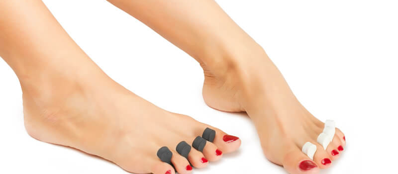 Feet with pedicure ropes and red nail polish