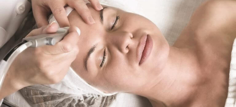 Diamond Tone Being Performed on Female Client Forehead