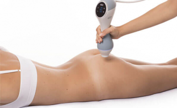 BTL unison cellulite treatment client lying on tummy